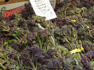 Purple broccoli, bunched, on display